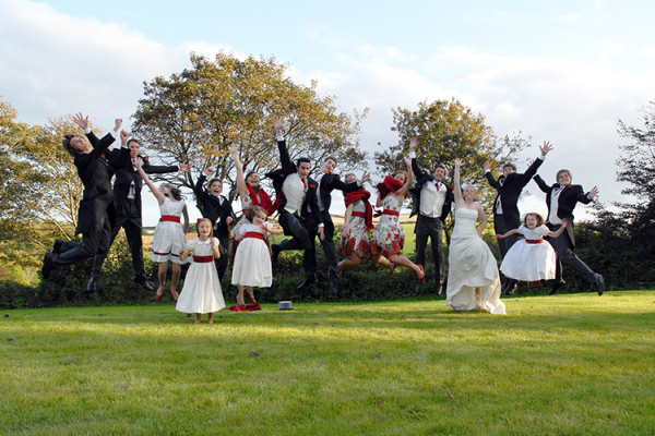 A bridal party having fun in the grounds at Tredudwell Manor in Cornwall