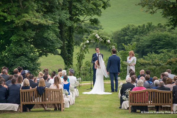 An outdoor wedding ceremony at Tredudwell Manor wedding venue in Cornwall | CHWV