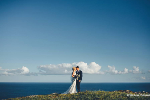 A couple enjoying the view from Tredudwell Manor wedding venue in Cornwall | CHWV