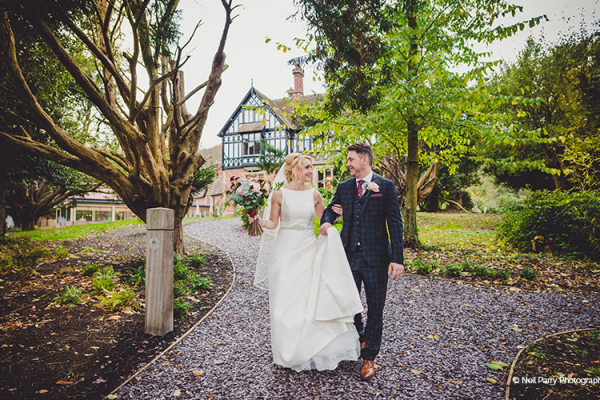 A happy couple in the grounds at Tyn Dwr Hall wedding venue in Denbighshire | CHWV