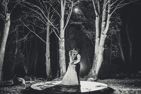 A happy couple in the grounds at Tyn Dwr Hall wedding venue in Denbighshire in the evening | CHWV