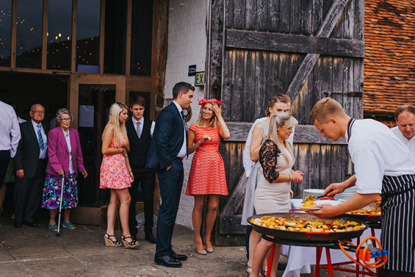 Paella evening food in the courtyard at Ufton Court barn wedding venue in Berkshire | CHWV