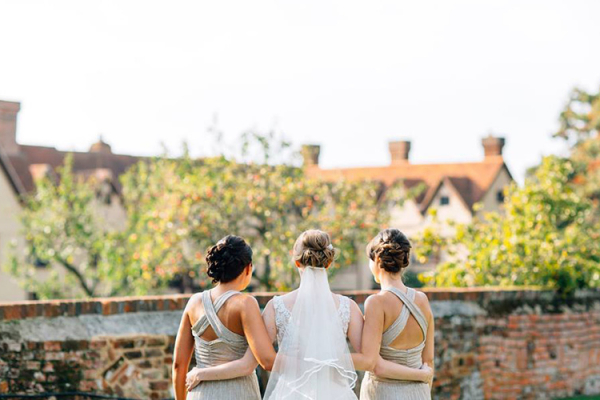 A bride and her bridesmaids at Ufton Court barn wedding venue in Berkshire | CHWV