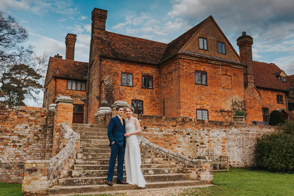 A couple in the grounds at the back of Ufton Court barn wedding venue in Berkshire | CHWV