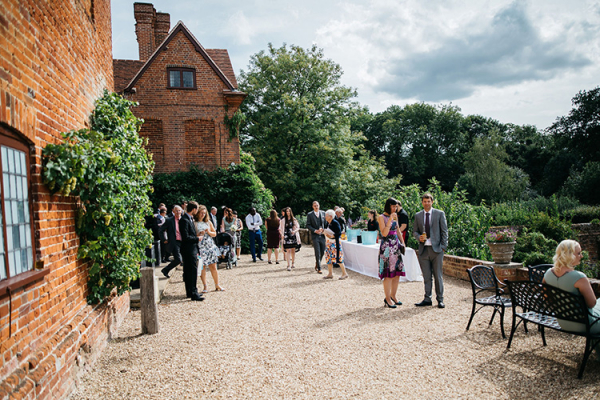 An outdoor drinks reception at Ufton Court barn wedding venue in Berkshire | CHWV