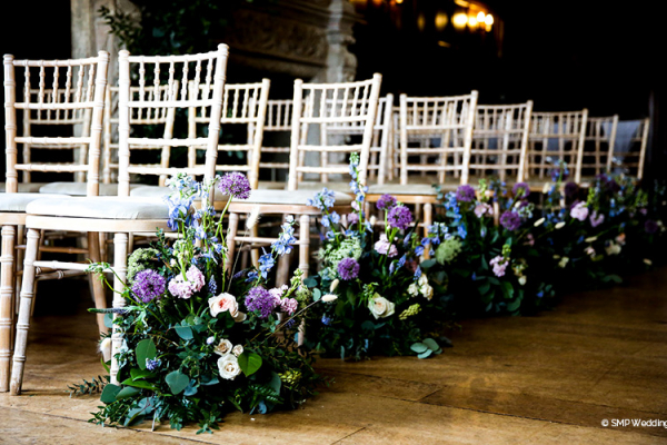 Beautiful ceremony flowers at Wakehurst country house wedding venue in West Sussex | CHWV