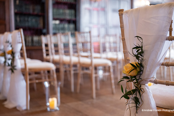 Beautiful ceremony flowers and candles at Wakehurst wedding venue in West Sussex | CHWV