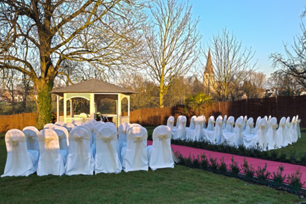 Outside wedding ceremony at Warwick House in Warwickshire