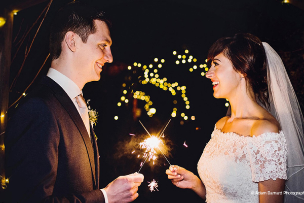 Celebrating with sparklers at Widbrook Grange country house wedding venue in Wiltshire | CHWV