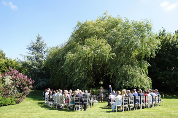 An outdoor wedding ceremony at Widbrook Grange country house wedding venue in Wiltshire | CHWV