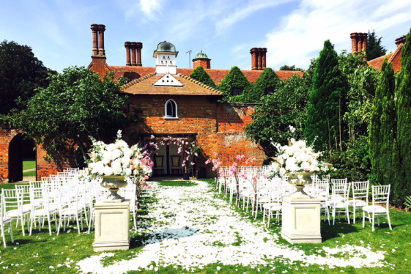 Set up for an outdoor ceremony at Woodhall Manor in Suffolk | CHWV