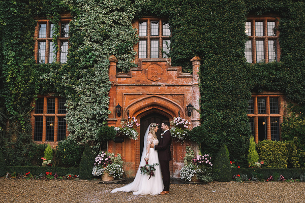 Happy couple taking a moment at Woodhall Manor wedding venue in Suffolk | CHWV