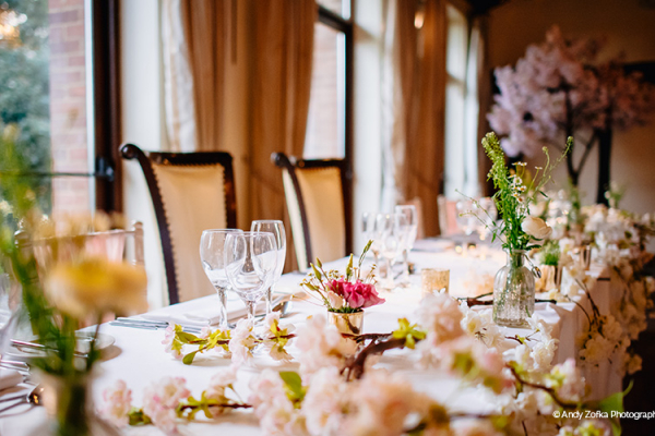 Floral table decorations at Woodhall Manor wedding venue in Suffolk | CHWV